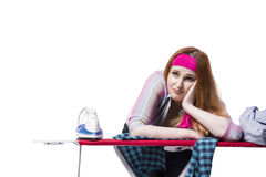 The young woman doing ironing isolated on white Stock Photography