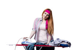 The young woman doing ironing  on white Royalty Free Stock Photo
