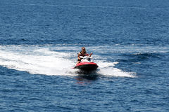 Young woman doing jet skiing. RODOS, GREECE - AUGUST 12: An unidentified young woman doing jet skiing in blue sea background on August 12, 2011 in Rodos, Greece Royalty Free Stock Photo