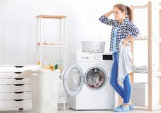 Young woman doing laundry Stock Photo