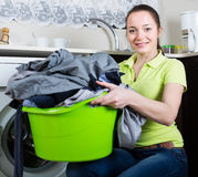 Young woman doing laundry at home Stock Images