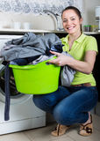 Young woman doing laundry at home Royalty Free Stock Photography