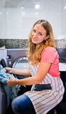 Young woman doing laundry (shallow DOF) Royalty Free Stock Images