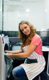 Young woman doing laundry (shallow DOF). Housework: young woman doing laundry (shallow DOF Royalty Free Stock Image