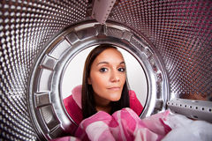 Young woman doing laundry Royalty Free Stock Image