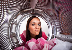Young woman doing laundry Royalty Free Stock Photos