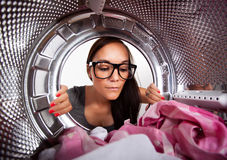 Young woman doing laundry Royalty Free Stock Photography