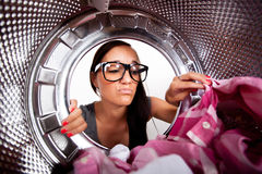 Young woman doing laundry Stock Image