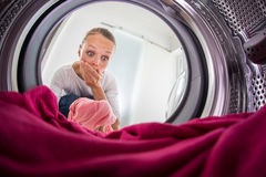 Young woman doing laundry Stock Photos