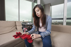 Young woman doing laundry work in living room at home Stock Images