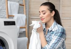 Young woman doing laundry. At home royalty free stock image