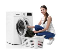 Young woman doing laundry. On white background royalty free stock photos
