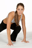 Young Woman Doing Leg Lunge. Beautiful Young Woman Doing Leg Lunge Royalty Free Stock Photos
