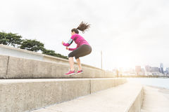 Young woman doing legs exercises with Chicago skyline on backgro Stock Image