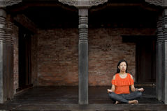 Young Woman Doing Lotus Position. Stock Photography