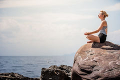 Young Woman doing Lotus Yoga Position Royalty Free Stock Photo