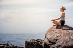 Young Woman doing Lotus Yoga Position Royalty Free Stock Photo