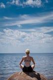 Young Woman doing Lotus Yoga Position Stock Photo