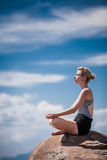Young Woman doing Lotus Yoga Position Royalty Free Stock Images