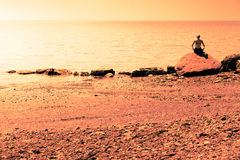 Young Woman doing Lotus Yoga Position in Front of the Ocean Royalty Free Stock Image