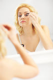 Young woman doing make up Royalty Free Stock Photo