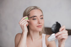 Young Woman Doing Makeup Concept Royalty Free Stock Image