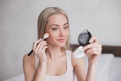 Young Woman Doing Makeup Concept Stock Photo