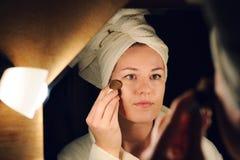 Young woman doing a makeup Stock Image