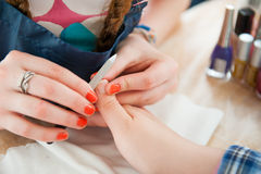 Young woman doing manicure Royalty Free Stock Photo