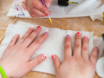 Young woman doing manicure Royalty Free Stock Images