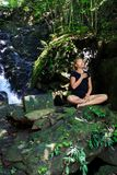 Young woman doing Meditating Royalty Free Stock Images