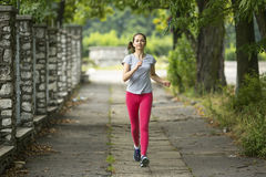 A young woman doing morning jog. In the Park Stock Image