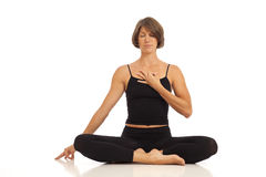 Young woman doing Namaste Hands Pose Royalty Free Stock Photo