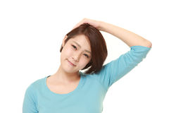Young woman doing neck stretch Stock Image
