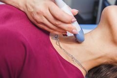 Young Woman Doing Neck Ultrasound Examination. At Hospital stock image