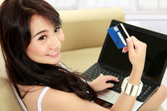 Young woman doing online shopping Stock Photography