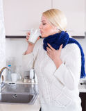 Young woman doing oral rinsing Stock Photos