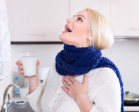 Young woman doing oral rinsing Royalty Free Stock Photo