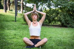 Young Woman Doing an Outdoor Yoga Exercise Royalty Free Stock Photography