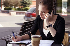 Young woman doing paperwork Royalty Free Stock Photos