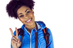 Young woman doing the peace sign Royalty Free Stock Image