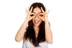 Young woman doing the perfect sign on eye. Royalty Free Stock Image