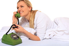 Young woman doing phone call in bed Royalty Free Stock Photo