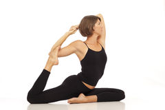 Young woman doing Pigeon Pose Royalty Free Stock Photo