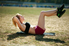 Young woman doing press fitness exercise for stomach muscles Royalty Free Stock Photo