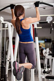 Young woman doing pull ups Stock Images