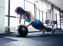 Young woman doing push up Stock Images