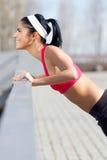 Young woman doing push-ups Stock Photography