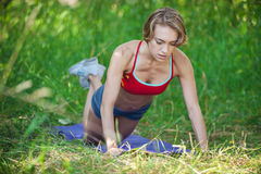 Young woman doing push ups exercise outdoors Royalty Free Stock Image