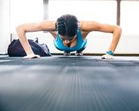 Young woman doing push ups Stock Image